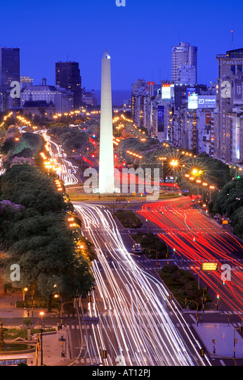 Aerial view of 9 de Julio Avenue, with Obelisco Monument, at dusk, with car lights as lines. Long exposure Buenos - Stock Image