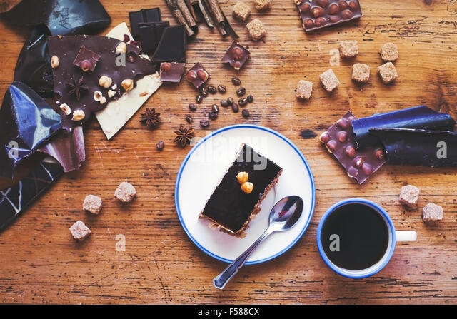 chocolate cake and coffee on the table, sweet dessert - Stock Image