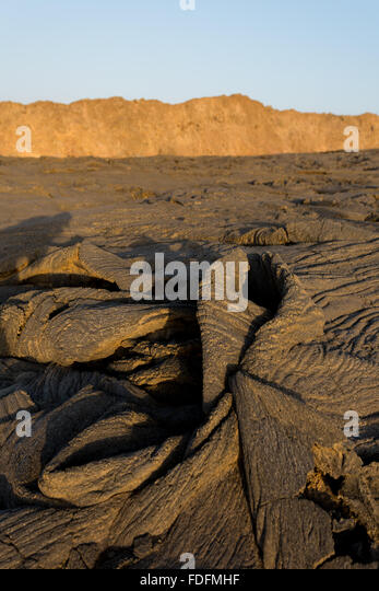 Rock folded like cloth at the summit of Erta Ale - Stock Image