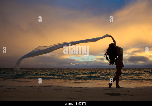 beautiful young woman on lanikai beach at sunrise - Stock Image