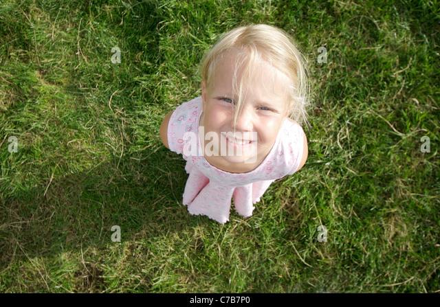 Girl looking upwards in summer, Eyendorf, Lower Saxony, Germany, Europe - Stock Image