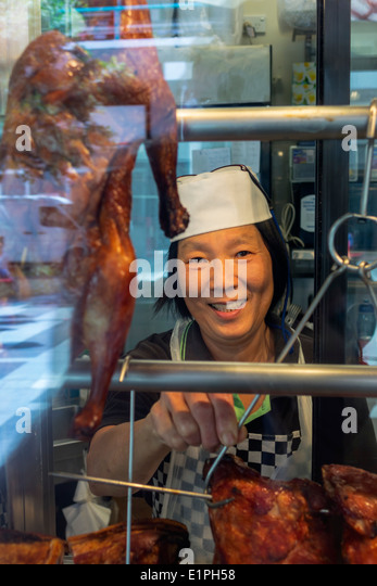 Brisbane Australia Queensland Fortitude Valley Chinatown Brunswick Street Asian woman restaurant cook chicken duck - Stock Image