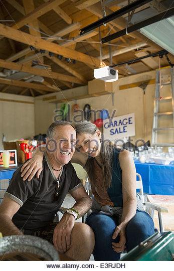 Couple hugging at garage sale - Stock Image