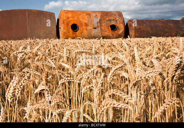 Cistern corroded in a field - Stock Image