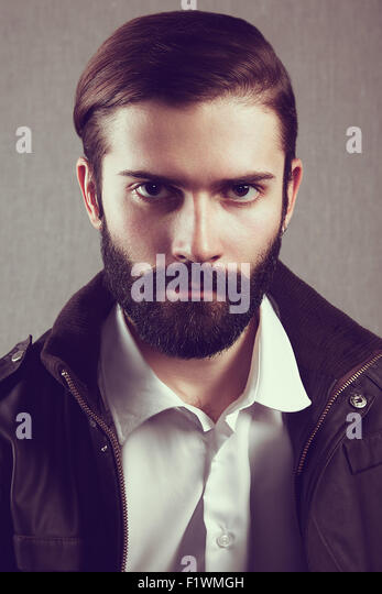 Portrait of handsome man with beard. Fashion photo - Stock Image