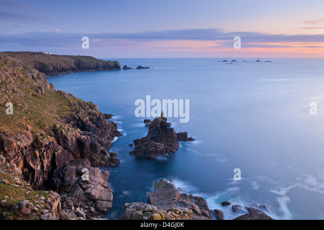 Land's End and Longships Lighthouse, Cornwall, England. Spring (May) 2012. - Stock Image