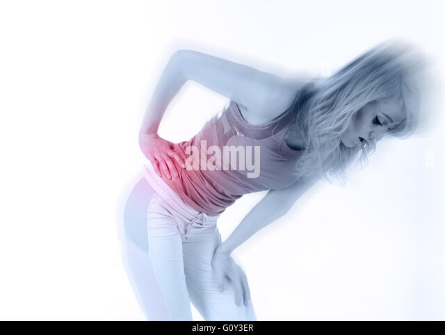Woman athlete bent over in pain with side stitch cramp - Stock Image