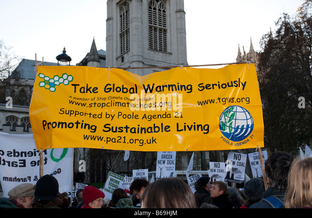 Campaigners with Take Global Warming Seriously banner on Climate Change March London December 2008 UK - Stock Image