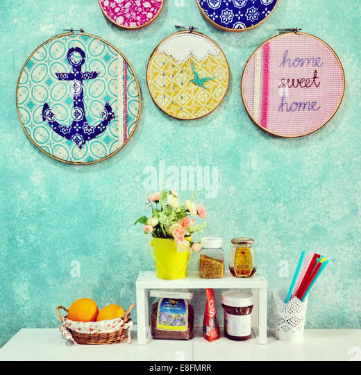Home sweet home arrangement of food, flowers and decorations - Stock Image