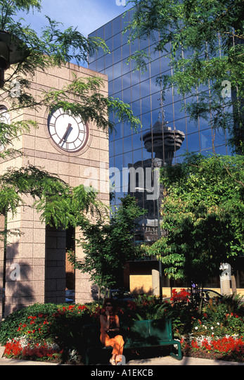 Vancouver Canada Park with Clock and Flowers Harbour Building Reflection - Stock Image