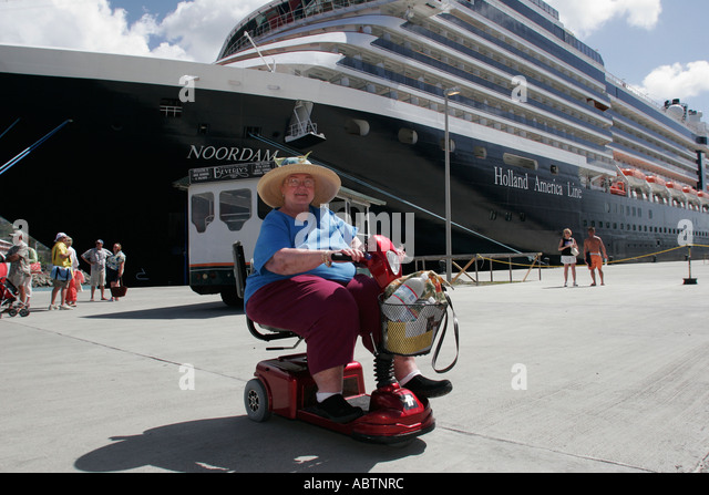 St. Thomas USVI Crown Bay Holland America Line ms Noordam woman disabled electric cart - Stock Image