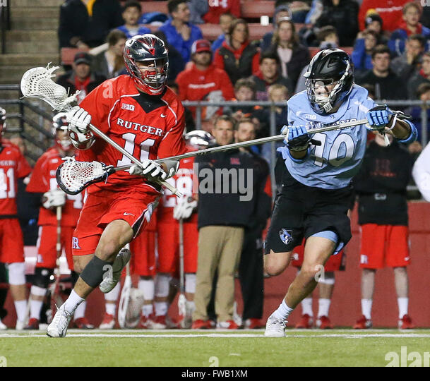 Piscataway, NJ, USA. 2nd Apr, 2016. Austin Spencer (40) tries to defend Jeff George (11) during an NCAA Lacrosse - Stock Image