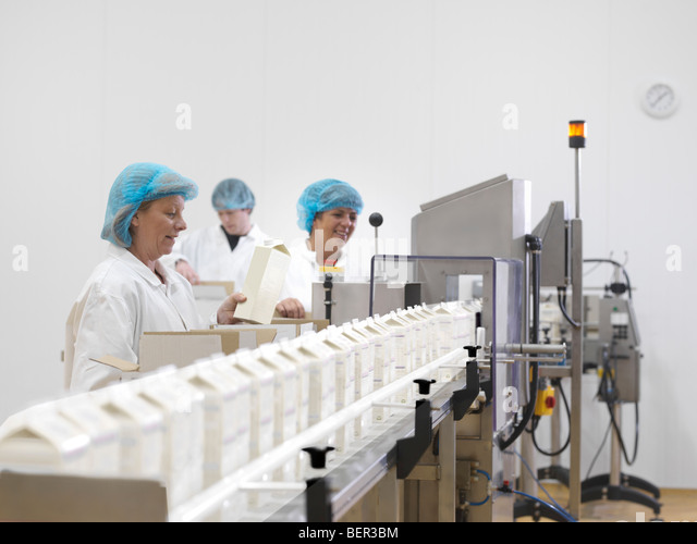 Food Workers On Production Line - Stock Image
