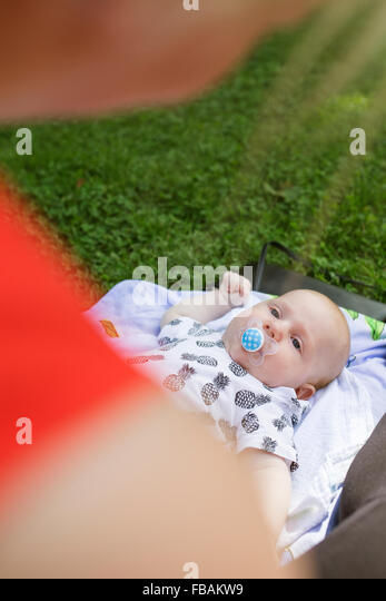 Finland, Mother with newborn son (0-1 months) - Stock Image