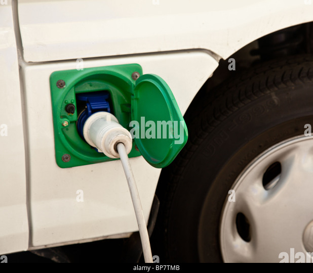 Electric car - The charging point of a new hybrid electric car being recharged with electricity close up of plug - Stock Image