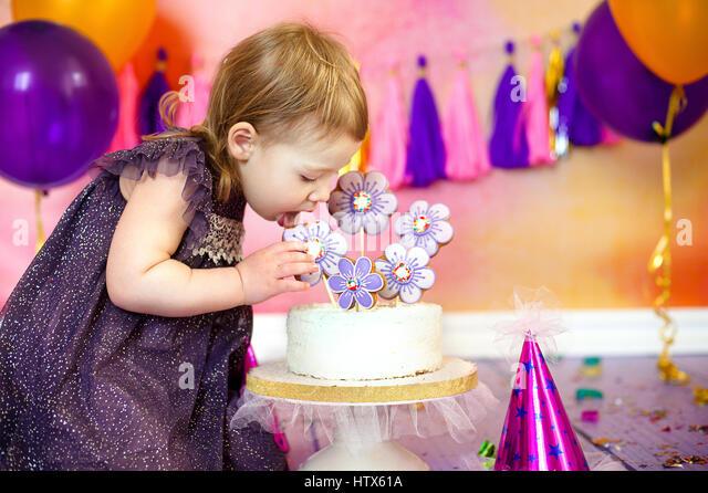 Happy Fancy Beautiful cute baby girl celebrates birthday two year. - Stock Image