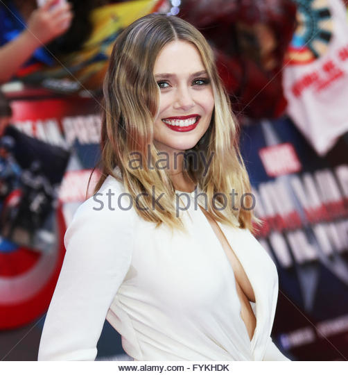 London,Great Britain. April 26th, 2016. UK, London: American actress Elizabeth Olsen poses on the red carpet for - Stock Image