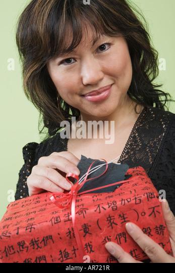 Woman offering gift - Stock-Bilder