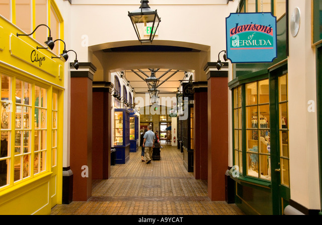 Bermuda Dockyard Clocktower shopping mall storefronts - Stock Image