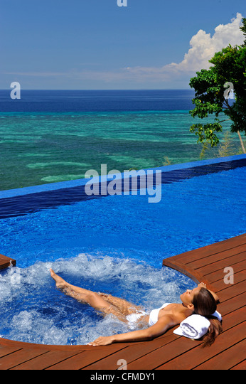 Girl in the jacuzi, Esacaia Resort and Spa, Bohol, Philippines, Southeast Asia, Asia - Stock Image