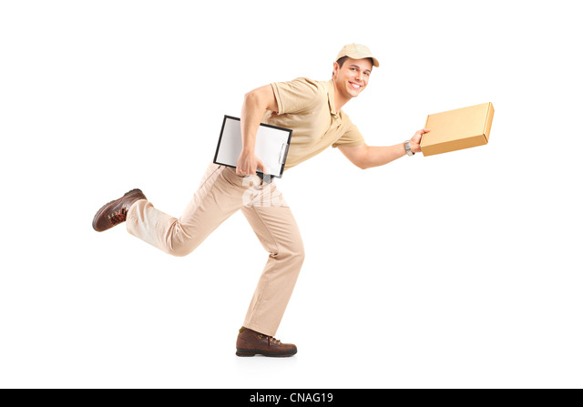 Delivery boy in a rush delivering a package isolated against white background - Stock Image