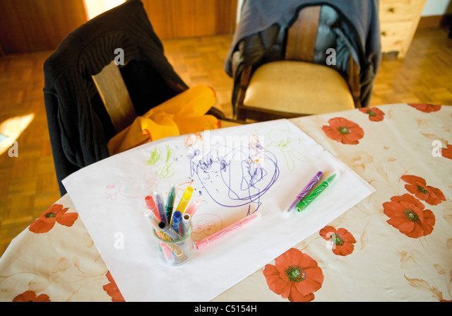 Child's drawing and color pens on table - Stock-Bilder