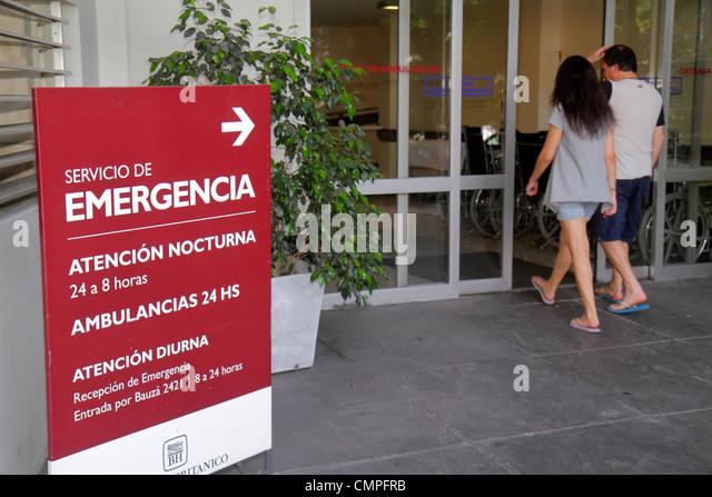 Uruguay Montevideo Hospital Britanico Avenida Italia Hispanic man woman couple entering sign emergency room entrance - Stock Image