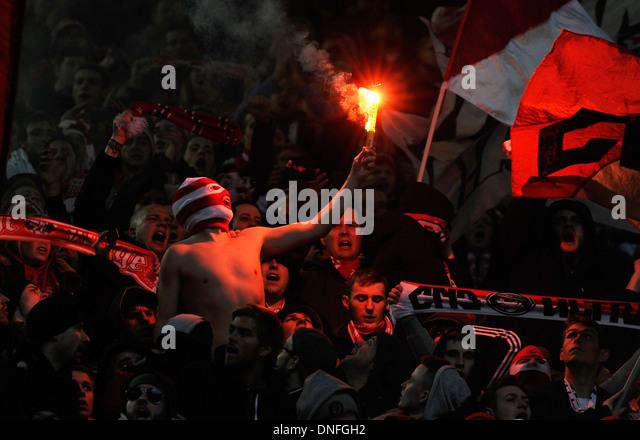 Supporters of German Football Bundesliga Club FC Köln (Cologne) celebrate their team burning flares - Stock Image