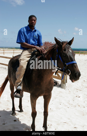 Turks and Caicos Grand Turk Indigenous Horse Shelter Black male stable workers - Stock Image
