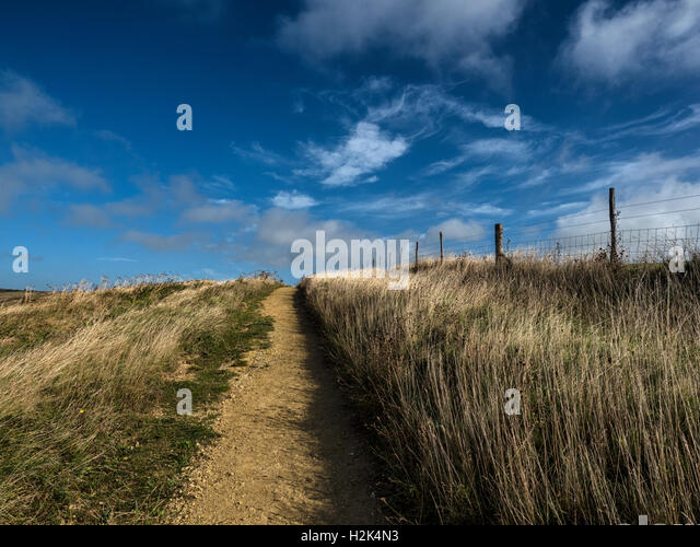 Bridleway beside East Brighton Golf Course (right) and Sheepcote Valley in the South Downs National Park, East Sussex, - Stock Image