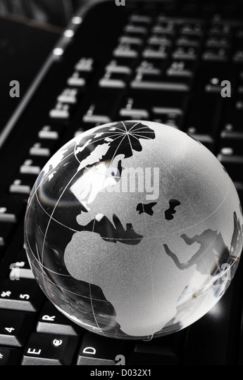 globe and keyboard showing global communication or internet concept - Stock Image