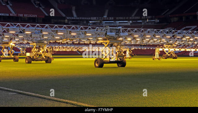 Lights keep grass pitches in summer condition in depths of winter,Old Trafford,Manchester,England,UK - Stock Image