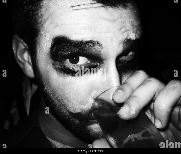 Portrait Of Joker Enjoying Drink In Party - Stock Image