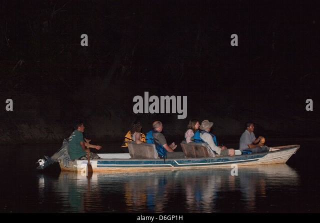Eco Tourists, Guide And Researchers Out Lamping For Caiman With Spotlight.  Yupukari,