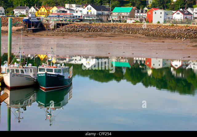 Fishing boats tied up at wharf, Digby, Nova Scotia, Canada - Stock Image
