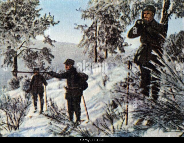 The contemporary colorized German propaganda photo shows a German snow shoe battalion in the Vosges mountains, France, - Stock Image