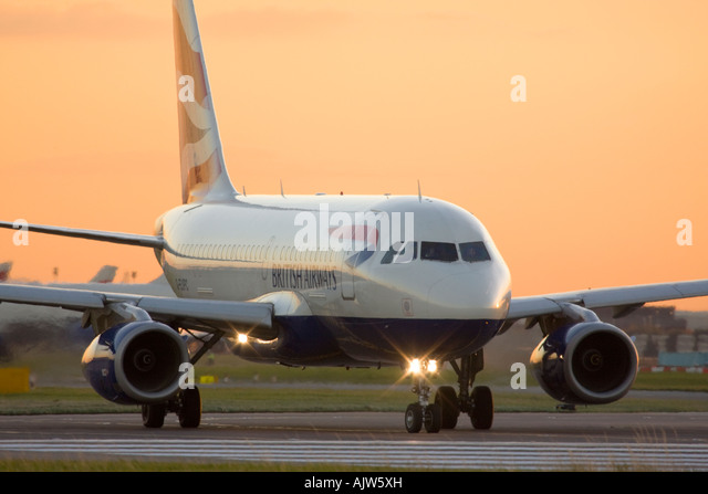 British Airways Airbus A319-131 taxiing for departure at Heathrow Airport, London, England, UK. - Stock Image