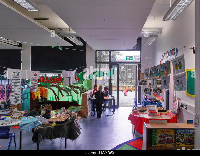 Classroom in use. Wembley High Technology College Primary, North Wembley, United Kingdom. Architect: Curl la Tourelle - Stock-Bilder