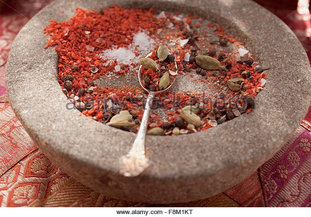 Spice mixture in mortar - Stock Image