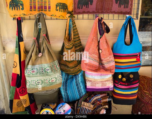 Colourful handbags in a market in Albayzin, Granada, Spain - Stock Image