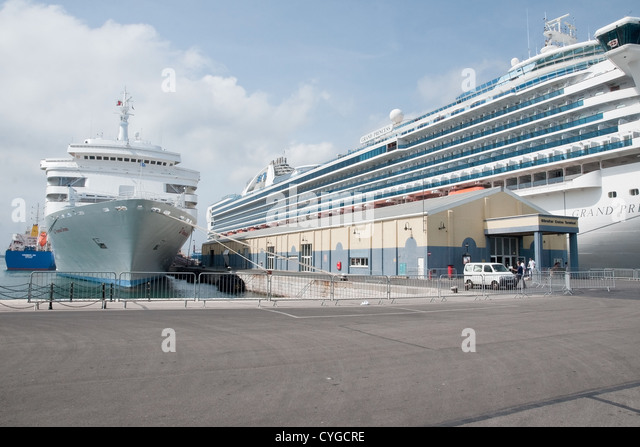 The cruise terminal at Gibraltar with the cruise liners Thomson Dream (left) and Grand Princess (right) alongside. - Stock Image