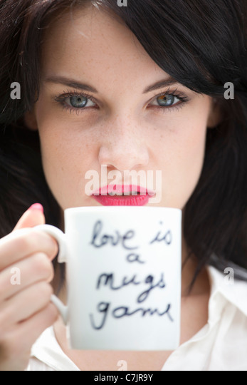 Close up of woman holding coffee cup - Stock-Bilder