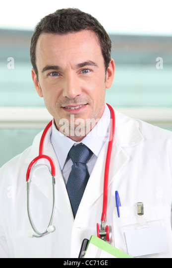 Portrait of a friendly hospital doctor - Stock Image