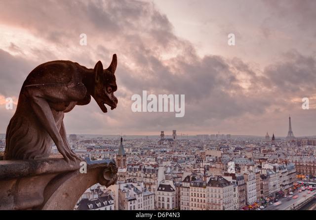 A gargoyle on Notre Dame de Paris cathedral looks over the city, Paris, France, Europe - Stock-Bilder