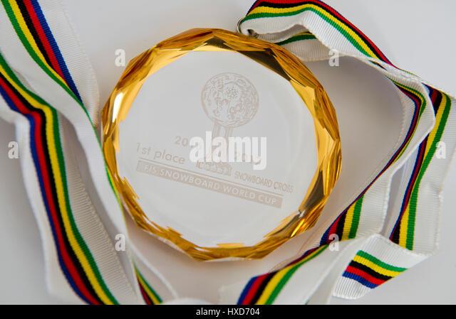 Prague, Czech Republic. 28th Mar, 2017. Czech snowboarder Eva Samkova shows her World Cup and gold medal during - Stock-Bilder