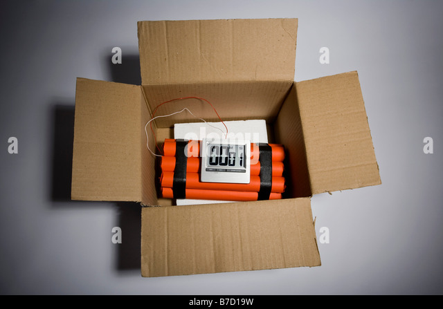 A dynamite time bomb in a cardboard box with 1 second left on the timer - Stock Image