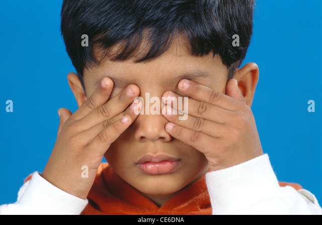 small young boy with both hands on eyes   MR#152 - Stock Image