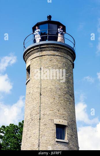 Wisconsin Kenosha Simmons Island Southport Light Station historic lighthouse built 1866 exterior woman women mother - Stock Image