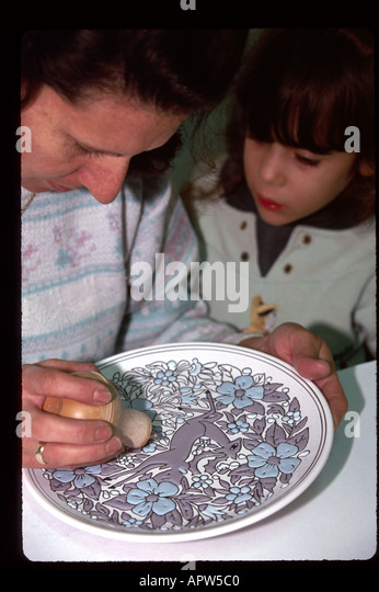 Greece Europe Isle of Rhodes Azourou Manousakis Ceramics artist glazes decorative plate girl watches - Stock Image