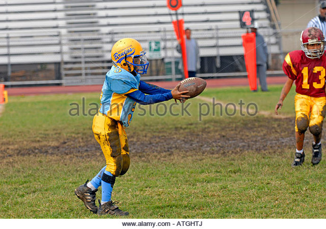 football player ready to kick ball - Stock Image